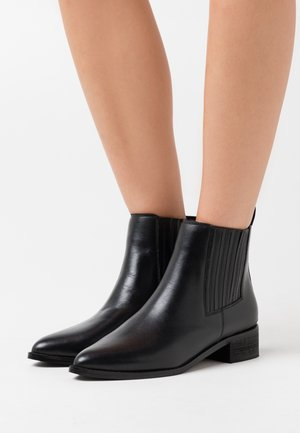 MAXIMO - Ankle boot - black