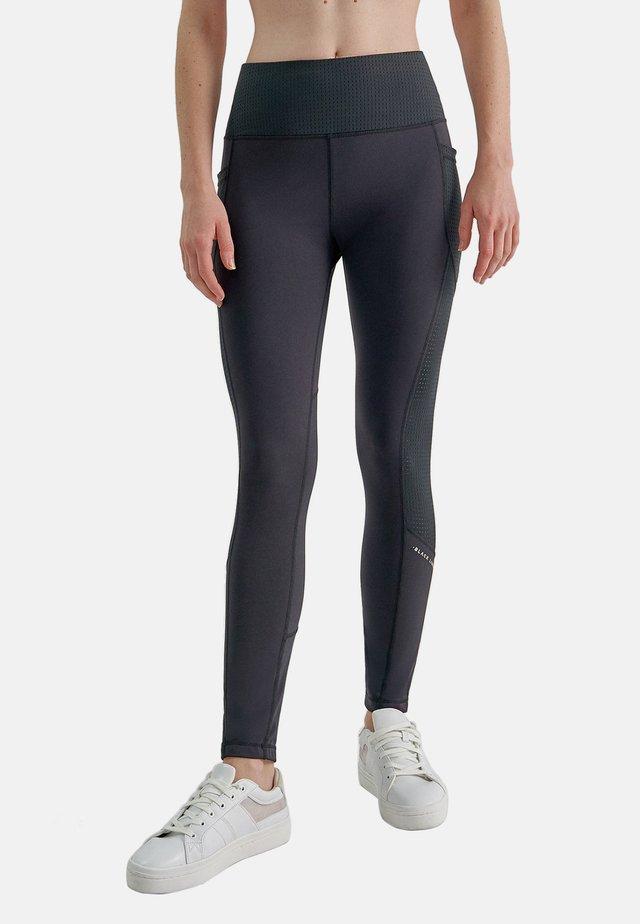 KOMO  - Leggings - Trousers - black