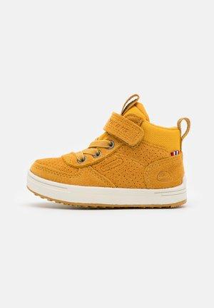 SAMUEL MID WP UNISEX - Hiking shoes - mustard