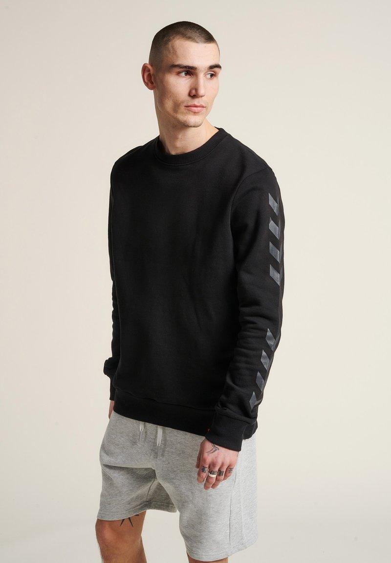 Hummel - Sweatshirt - schwarz