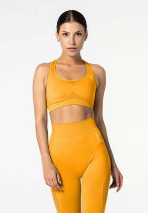 PHASE SEAMLESS - Sports bra - yellow