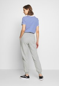 Monki - KARDI PANTS - Tracksuit bottoms - grey melange - 2