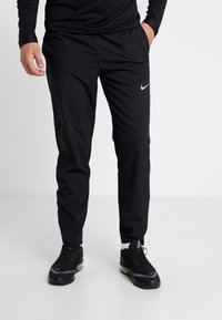 Nike Performance - RUN STRIPE PANT - Tracksuit bottoms - black/silver - 0