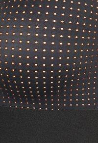 ONLY Play - ONPJAMA BRA - Light support sports bra - black/sunset orange - 2
