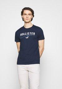 Hollister Co. - CORE TECH SOLID - Camiseta estampada - navy - 0