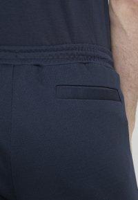 BOSS - HEADLO WIN - Pantalon de survêtement - blue/silver - 3