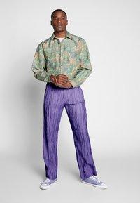 Hope - HIDE TROUSER - Trousers - purple - 1
