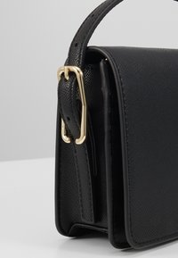 Tommy Hilfiger - HONEY FLAP CROSSOVER - Across body bag - black - 2