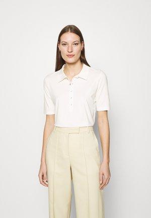 NELLY - Polo shirt - whispwhite