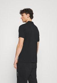 Nike Sportswear - THE SLIM  - Polo shirt - black - 2
