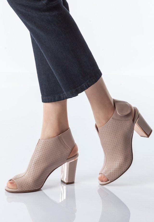 Peeptoe heels - nude