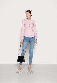 Tommy Hilfiger - REGULAR SHIRT - Button-down blouse - pink - 1