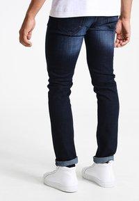 Zalando Essentials - Slim fit jeans - dark blue - 2