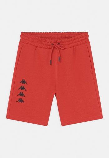JULIO UNISEX - Sports shorts - aurora red