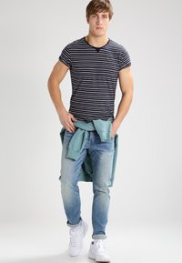 Scotch & Soda - Slim fit jeans - blue denim - 1