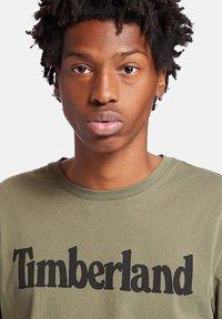 Timberland - KENNEBEC RIVER LINEAR TEE - Print T-shirt - grape leaf - 2