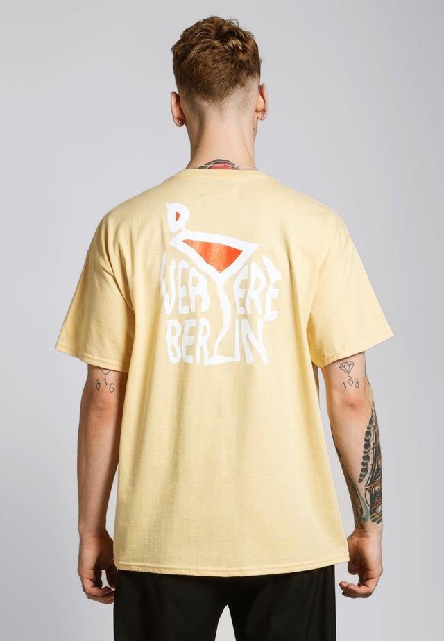 T-shirt imprimé - pastell-gelb