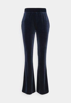 VIVELVETTA FLARED PANT - Tracksuit bottoms - navy blazer