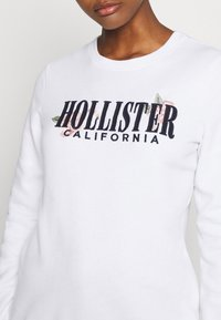 Hollister Co. - CHAIN CROPPED ICON  - Sudadera - white - 5