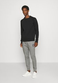 Tommy Hilfiger - ICON - Tracksuit bottoms - grey - 1