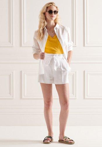 ORGANIC  POCKET  - Basic T-shirt - pigment yellow