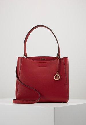 FABIENNE - Handbag - rot