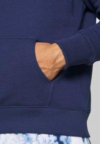 Fanatics - NFL NEW ENGLAND PATRIOTS GLOW CORE GRAPHIC HOODIE - Club wear - navy - 6