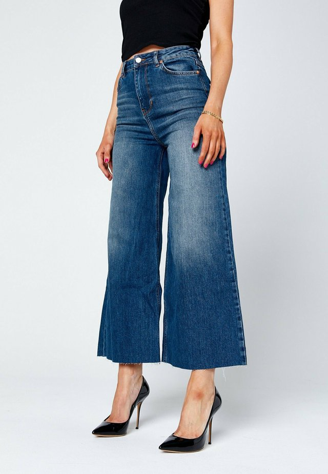 Flared Jeans - dark-blue denim