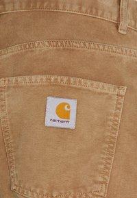 Carhartt WIP - NEWEL PANT DEARBORN - Trousers - hamilton brown - 2