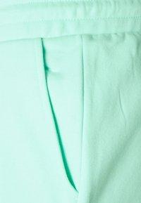 YOURTURN - UNISEX - Tracksuit bottoms - light blue - 2