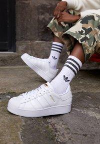 adidas Originals - SUPERSTAR BOLD - Trainers - footwear white/gold metallic - 4