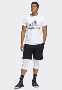 adidas Performance - N3XT L3V3L SHORTS - Sports shorts - black - 1
