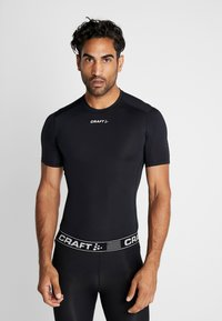 Craft - PRO CONTROL COMPRESSION TEE - T-Shirt print - black - 0
