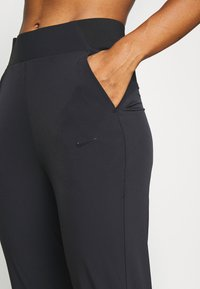 Nike Performance - BLISS - Tracksuit bottoms - black - 5