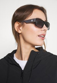 adidas Originals - Sunglasses - shiny black/smoke - 1
