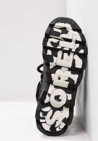 Sorel - KINETIC - Winter boots - black/white - 6
