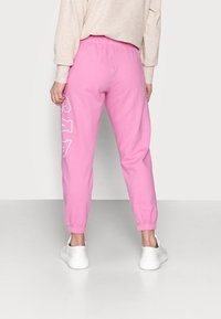 GAP Petite - EASY - Tracksuit bottoms - pink - 2