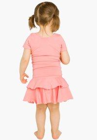 GUGGUU - T-SHIRT DRESS FRILLA - Day dress - pastel coral - 1