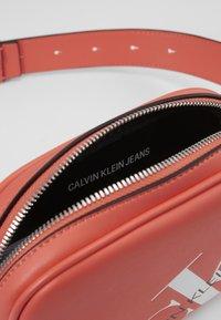Calvin Klein Jeans - ROUNDED WAISTBAG - Bum bag - orange - 4