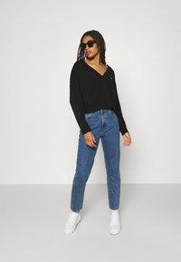 Tommy Jeans - SOFT V NECK - Sweatshirt - black - 1