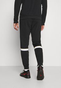 Nike Performance - ACADEMY SUIT - Träningsset - black/saturn gold/white - 4