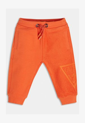 TERRY - Tracksuit bottoms - orange