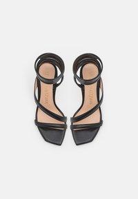 Stuart Weitzman - BEATRIX WRAP - Sandals - black/gold - 4
