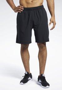 Reebok - Reebok Austin II Solid Shorts - Krótkie spodenki sportowe - Black - 0
