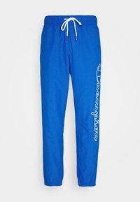 ELASTIC CUFF PANTS - Tracksuit bottoms - blue