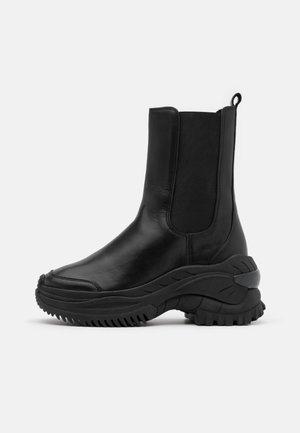 CHAINY - Platform ankle boots - black
