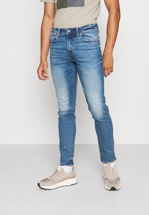 SKINNY - Jeans Tapered Fit - jet indigo