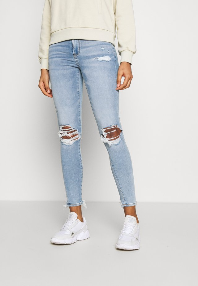JEGGING - Jeans slim fit - busted bright