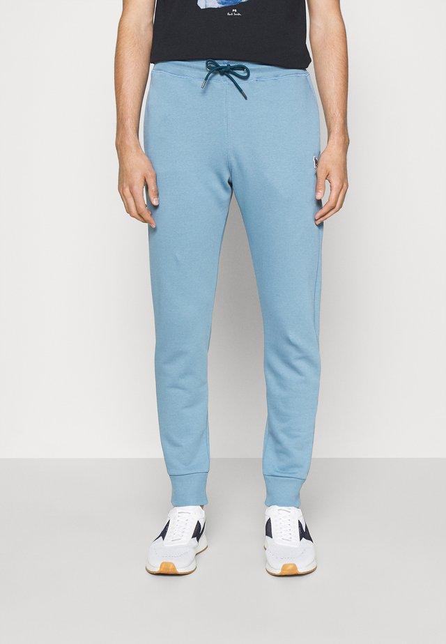 SLIM FIT JOGGER - Tracksuit bottoms - blue