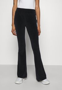 Karl Kani - SIGNATURE RHINESTONE FLAREDLEGGINGS  - Leggings - Trousers - black - 0